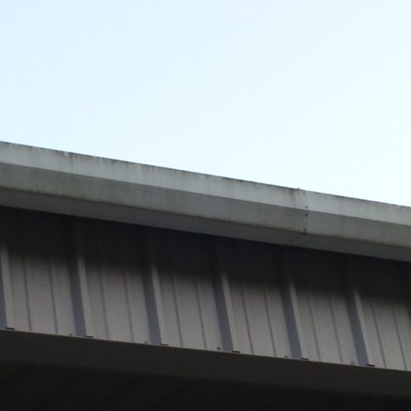 Industrial Gutter Before Power Washing