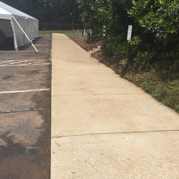 Parking lot sidewalk after power washed